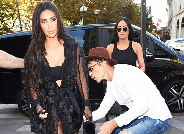 Kim Kardashian is to sue a journalist for an attempt to kiss her butt