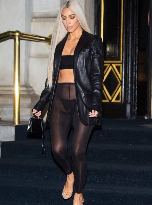 Kim Kardashian in the street wearing transparent tights